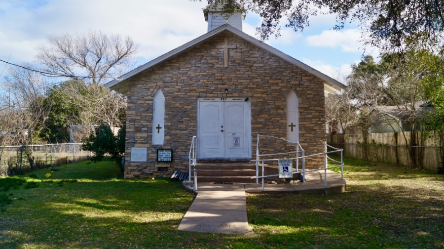 Off Sheppard Street in Round Rock lies a one-room white church, with etchings of its founders' names carved into marble to the left of the front door. Centered in the heart of the city, St. Paul African Methodist Episcopal Church traces its origin back more than 135 years. (Kelsey Thompson/Community Impact Newspaper)