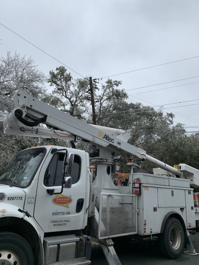 Austin Energy crews were in the Apache Shores neighborhood Feb. 12 to remove tree limbs from power lines. (Greg Perliski/Community Impact Newspaper)