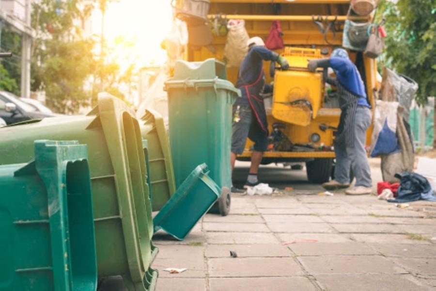 men picking up trash