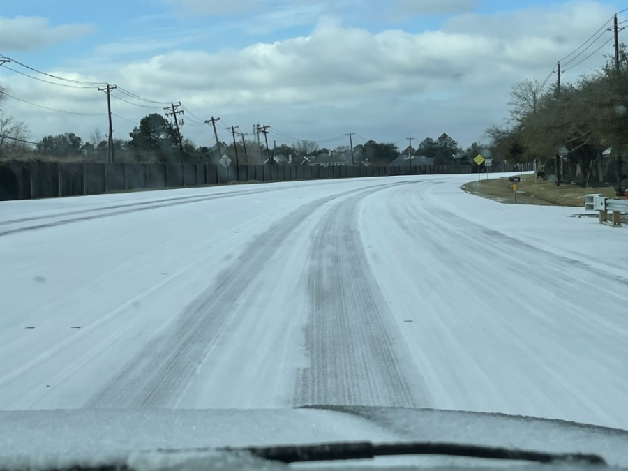 This morning, Parkwood Avenue in Friendswood saw a thin blanket of snow. (Courtesy Alison Daniel)