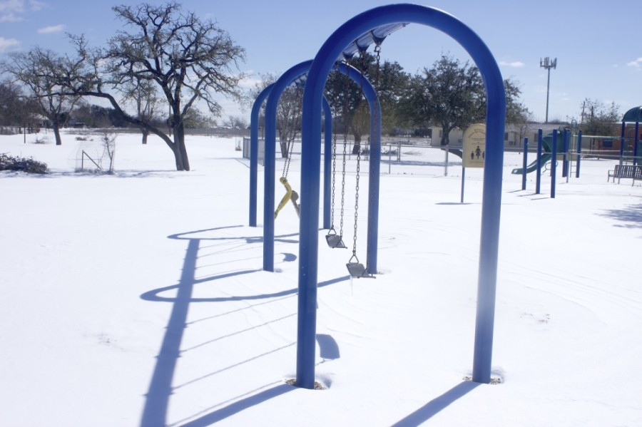 Snow covers the playground at Pecan Springs Elementary School in Austin ISD Feb. 15. (Jack Flagler/Community Impact Newspaper)