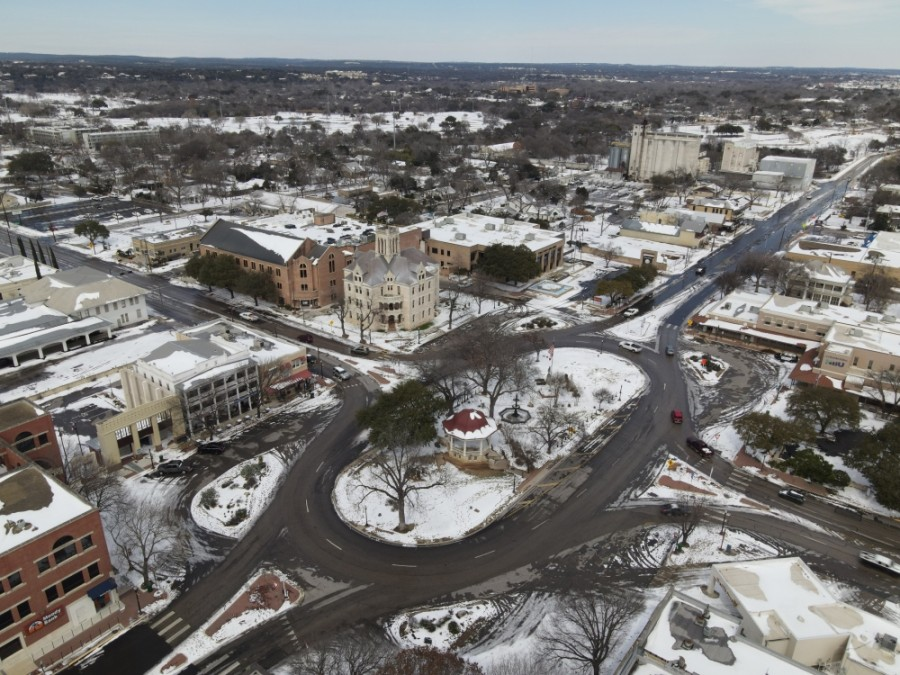 Downtown New Braunfels is blanketed in snow. (Warren Brown/Community Impact Newspaper)
