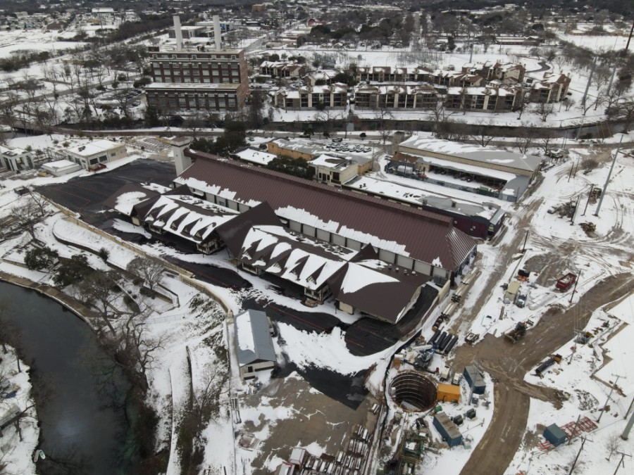 The newly rebuilt Wursthalle at Wurstfest is covered in snow, Feb. 16, 2021. (Warren Brown/Community Impact Newspaper)