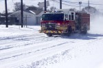An Austin Fire Department truck drives down Manor Road on Feb. 15. (Jack Flagler/Community Impact Newspaper)