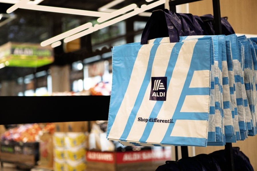 Aldi grocery bags hanging in a store