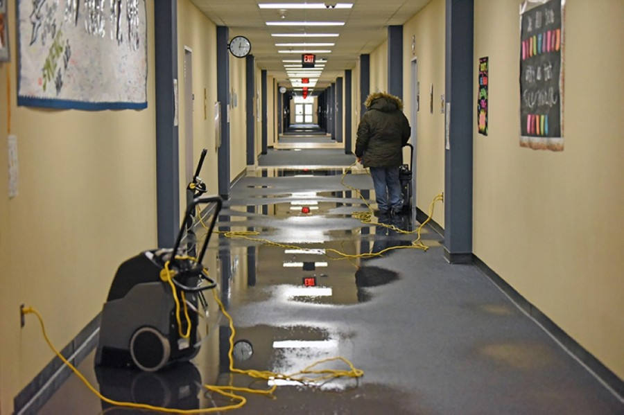 Restoration crews at Swenke Elementary School work to clean up water from the floors following freezing temperatures this week that caused pipe damage to campuses. (Courtesy Cy-Fair ISD)