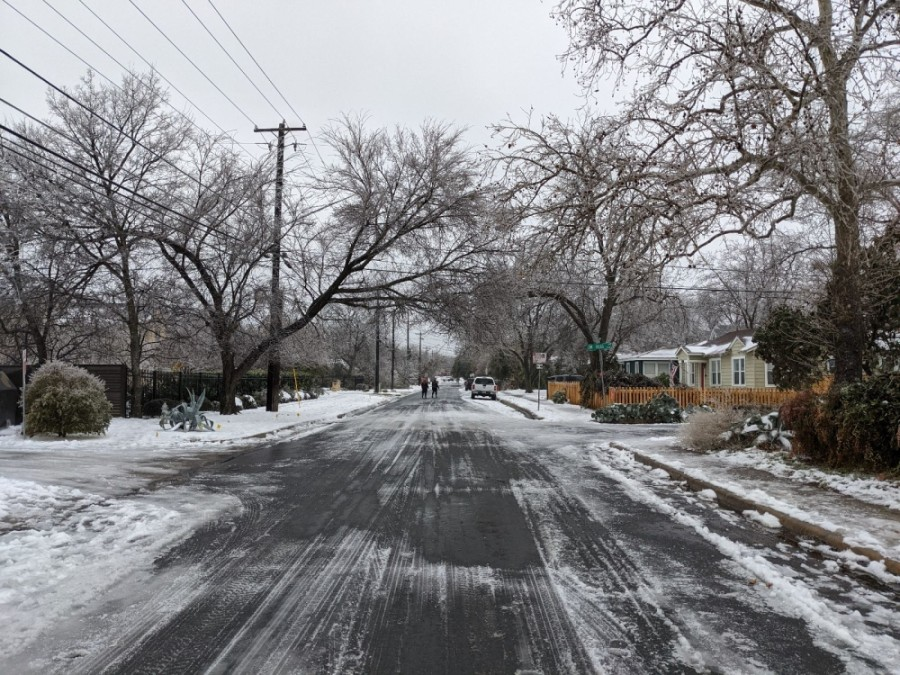 A residential road in Central Austin remains covered in snow and ice the morning of Feb. 17. (Iain Oldman/Community Impact Newspaper)
