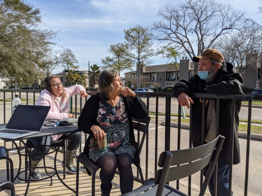 Janice Rains-Moran (center) and her daughter Danielle Rains speak in late January with Troy, one of the many homeless people who live in Clear Lake. (Jake Magee/Community Impact Newspaper)