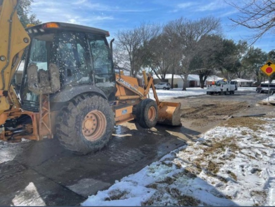 Bulldozers clear debris from the streets of Richardson following the winter storm. (Courtesy city of Richardson)