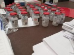 Photo of a desk with vials of Moderna vaccines on top