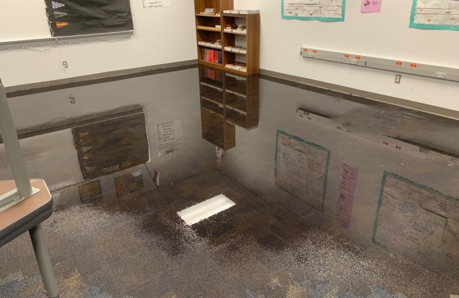 Standing water covering the floor in a carpeted classroom
