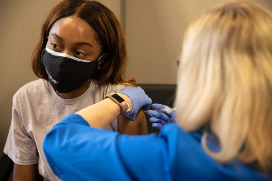 Dallas resident Alisia Thomas, a health care worker, receives her first dose of the Pfizer vaccine Feb. 5. (Liesbeth Powers/Community Impact Newspaper)