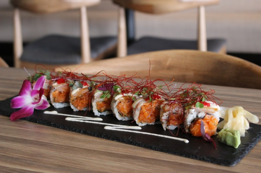 The Kamille roll ($17) includes spicy salmon and torched yellowtail topped with ito togarashi, a shredded Japanese red chili pepper garnish. (Adriana Rezal/Community Impact Newspaper)