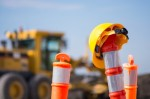 Traffic cone, hard hat, construction equipment, motor grader. (Courtesy Fotolia)