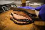 Photo of a knife cutting through brisket