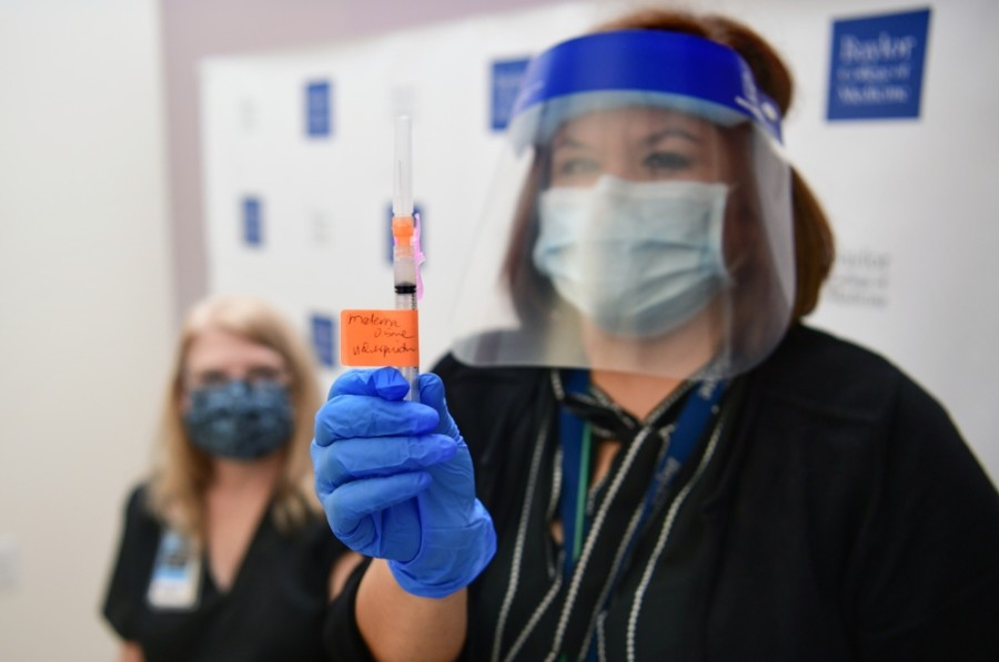 An health care worker with the Baylor College of Medicine holds up a Moderna vaccine. (Courtesy Baylor College of Medicine)