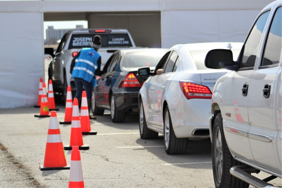 Cars wait their turn for a vaccine dose at the Texas Motor Speedway on Feb. 2. The hub was hosted by Denton County Public Health. (Sandra Sadek/Community Impact Newspaper)