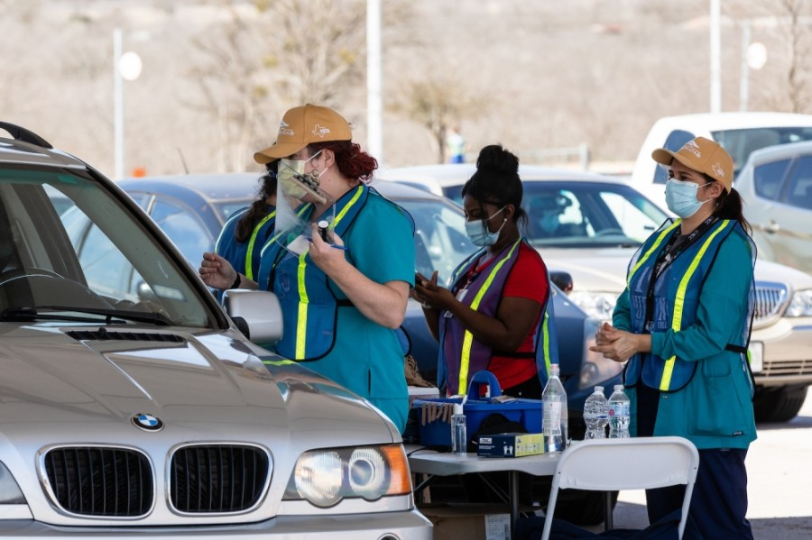 Photo of nurses giving drive-thru vaccines