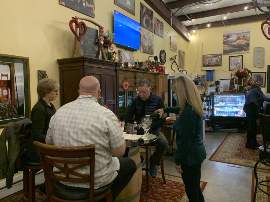 Randi Wingate pours wine for guests at Bent Oak Winery. The winery is operating its tasting room at 50% capacity and is offering reservations to book tables in advance. (Greg Perliski/Community Impact Newspapers)