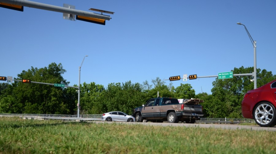 "Intersection improvements include a displaced left-turn lane, an intersection component aimed at providing ""congestion relief within the existing right-of-way,"" according to a city news release. (John Cox/Community Impact Newspaper)"
