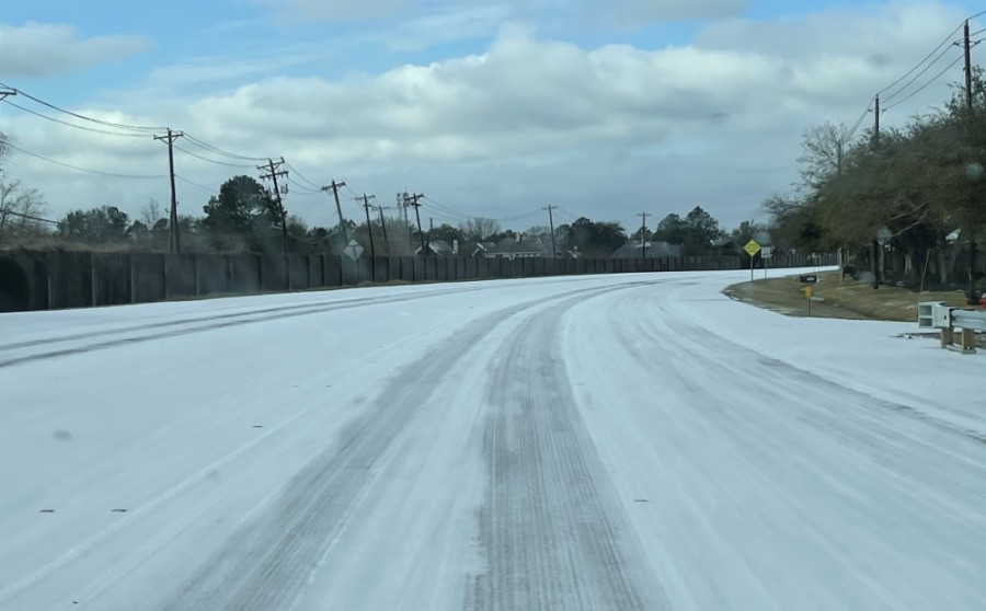 Parkwood Avenue in Friendswood saw a thin blanket of snow Feb. 15. Throughout the week, millions across the state, including in Pearland and Friendswood, experienced power outages, burst pipes and other problems as a result of the frigid temperatures. (Courtesy Alison Daniel)