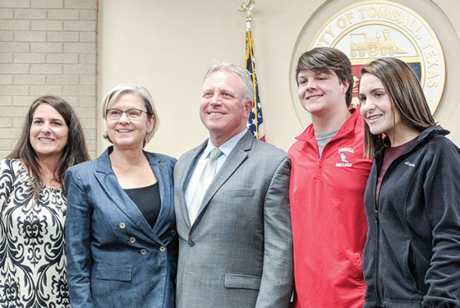 Rob Hauck (center) is pictured with Mayor Gretchen Fagan (second from left) and his family following his appointment as Tomball City Manager in 2018. (Anna Lotz/Community Impact Newspaper)