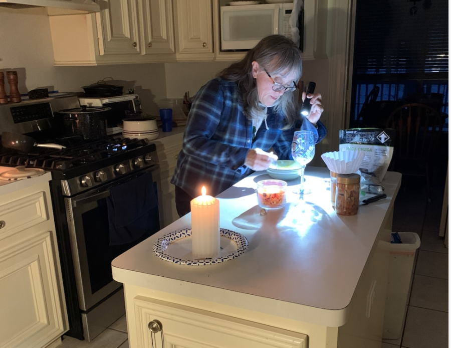 Betsy Stern, a resident of Sendera Ranch, uses a flashlight and candles during the February winter storm that left millions of Texans without power. Most of the Conroe, Montgomery and Willis areas are served by Entergy Texas, which lies outside the state grid. (Courtesy Betsy Stern)