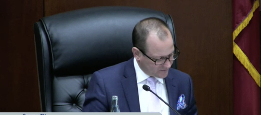 Conroe Mayor Jody Czajkoski reads the agenda item regarding the purchase at a March 11 City Council meeting. The item was discussed during executive session. (Screenshot via Conroe City Council livestream)