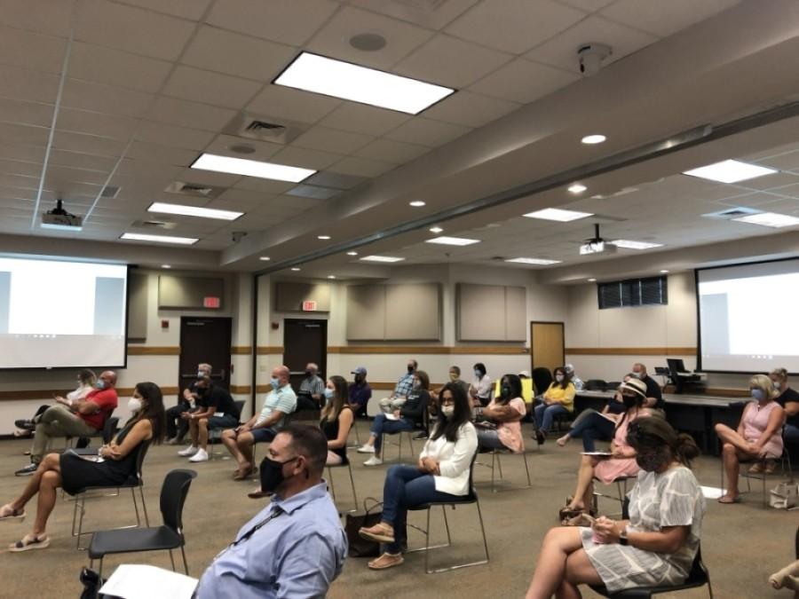 Lake Travis ISD community members attend a meeting in August. (Amy Rae Dadamo/Community Impact Newspaper)
