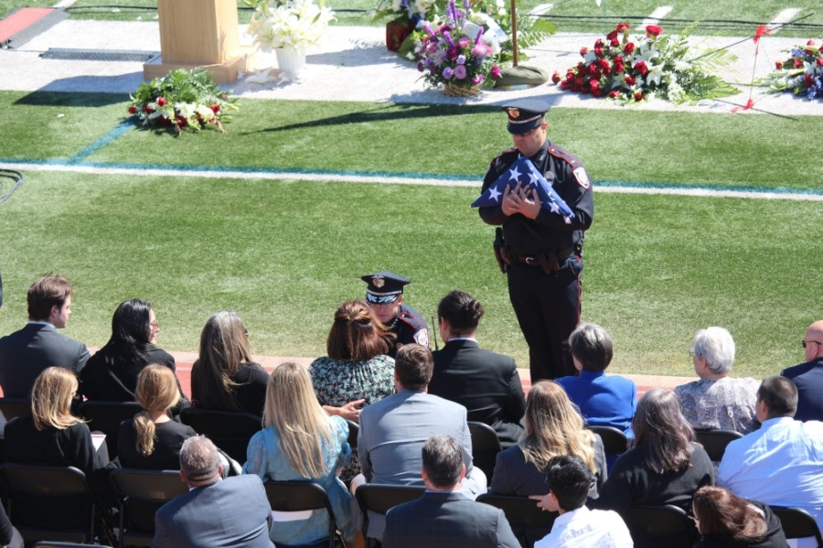 The Tomball Police Department presented two flags to the family of the late Rob Hauck during the March 19 memorial service. (Anna Lotz/Community Impact Newspaper)