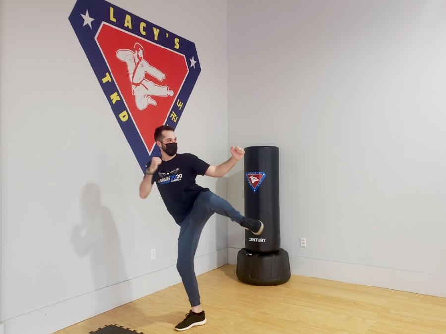 Owner Bobby Lacy has been practicing taekwondo since her was 10 years old. (Ali Linan/Community Impact Newspaper)