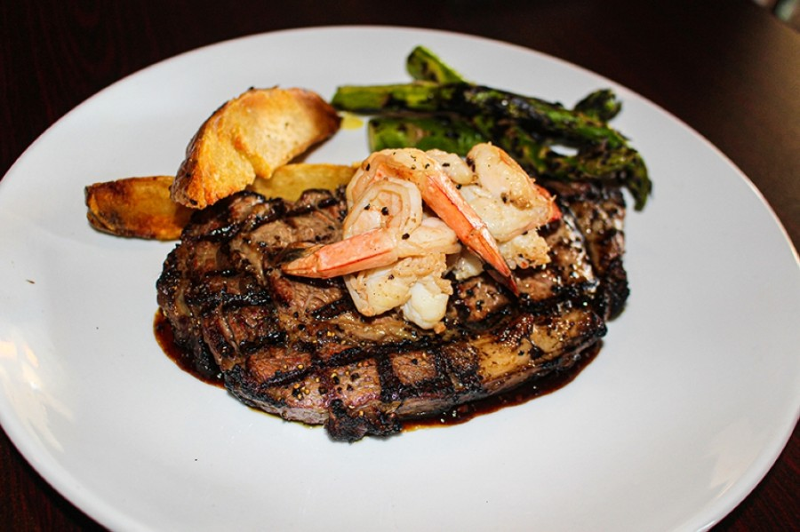 The prime 16-ounce ribeye is served with potatoes and asparagus as a main dish option. (Eva Vigh/Community Impact Newspaper)
