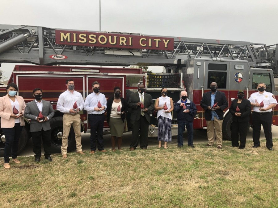 "Missouri City City Council, along with other city leaders and project contractors, participated in a ""rollout"" ceremony March 24. (Claire Shoop/Community Impact Newspaper)"