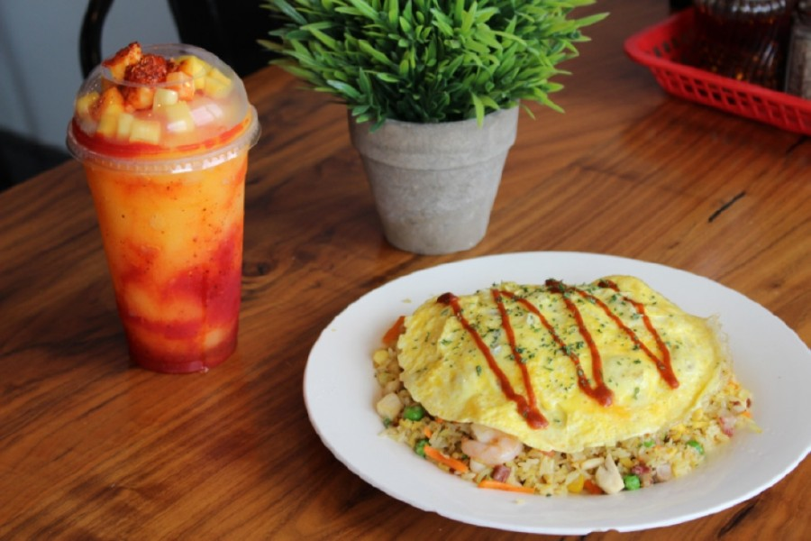 Street Food Guru's menu includes the Mangonada ($5.49) specialty tea and special fried rice ($7.99). (Adriana Rezal/Community Impact Newspaper)