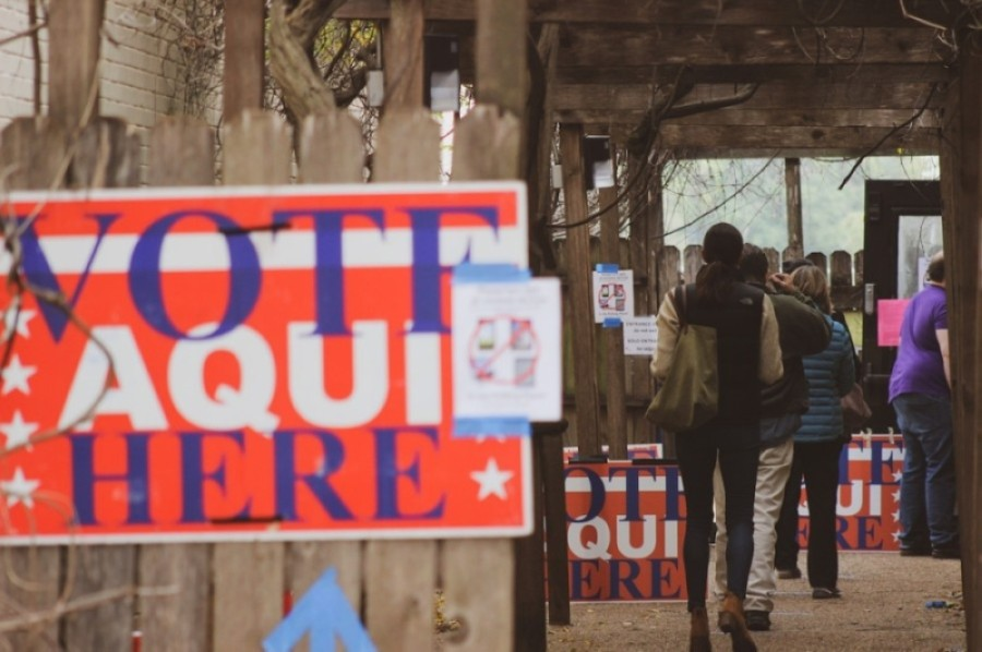 Voters wait in line during the Dec. 15 runoff elections in Austin. (Community Impact Newspaper Staff)