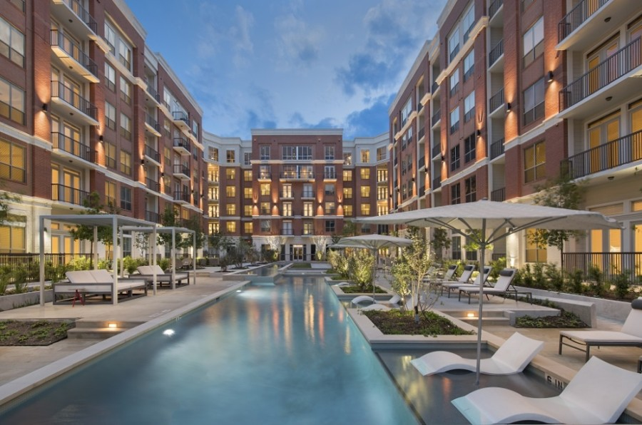 The Mark at CityPlace Springwoods Village features a resort-style pool with a separate lap pool, cabanas, and outdoor kitchen and dining areas. (Courtesy Public Content)