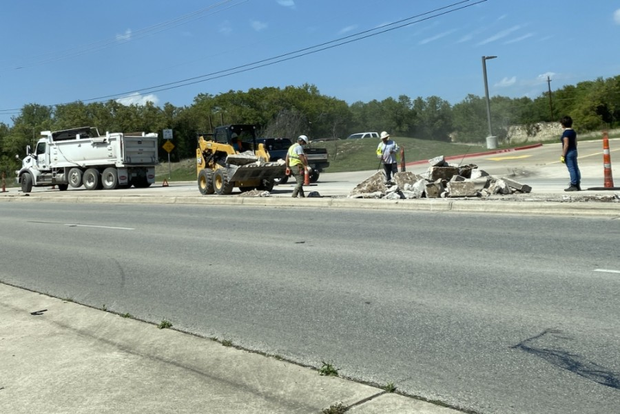 Bee Cave city maintenance crew members are rebuilding the existing median at Bee Cave Parkway and Bee Cave Road to make room for a longer left-turn for eastbound motorists heading north on Bee Cave Road. (Greg Perliski/Community Impact Newspaper)