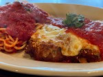 The chicken Parmesan ($6) is dipped in Parmesan breading, topped with marinara sauce and mozzarella cheese, and served over spaghetti. (Courtesy Raymond Green)