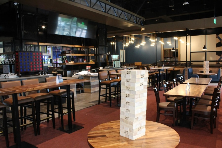 REVL Social Club offers bar food and cocktails with games such as Jenga and Connect 4 for guests to use. (Megan Cardona/Community Impact Newspaper)