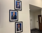 Outside of Hutto City Council Chambers there is a vacant spot where former Council Member Patti Martinez's framed picture used to hang. (Megan Cardona/Community Impact Newspaper)