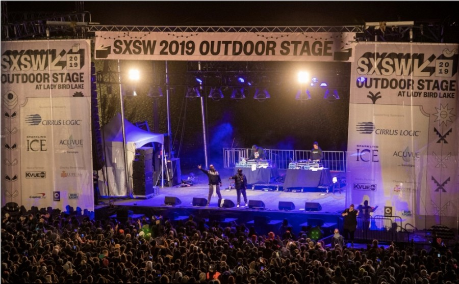 Photo of two performers on an outdoor SXSW stage