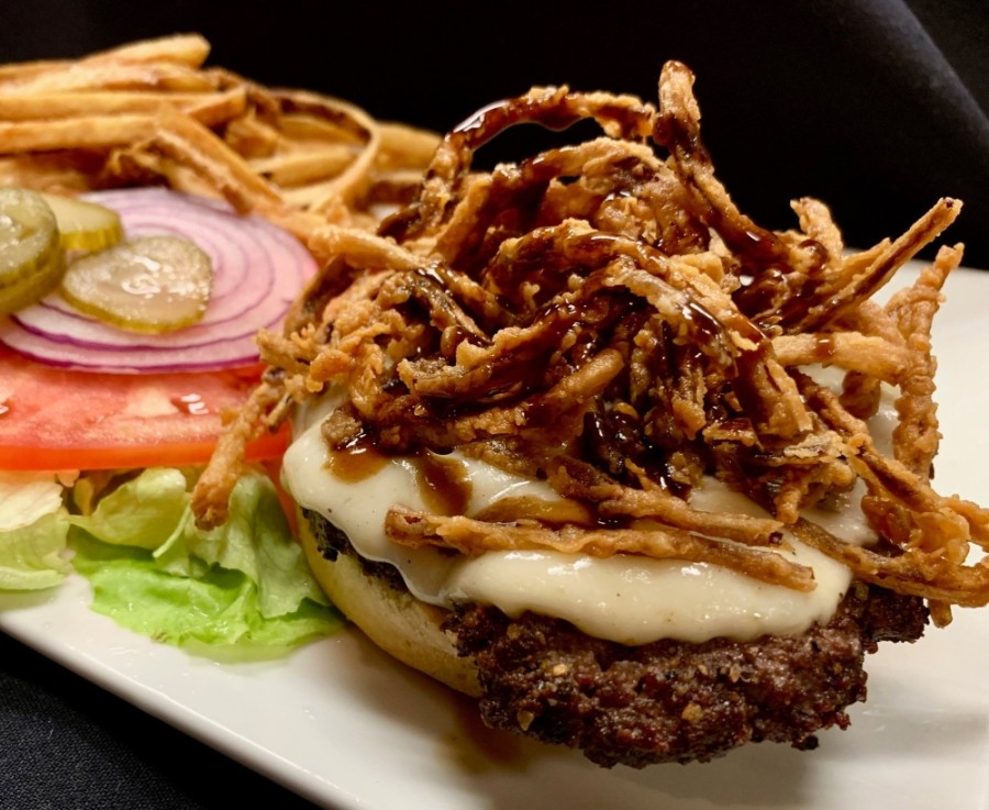 The Cool Cafe Burger ($14) features a cast-iron cooked beef patty topped with fried onions, provolone cheese and a housemade steak sauce. (Courtesy Cool Cafe)