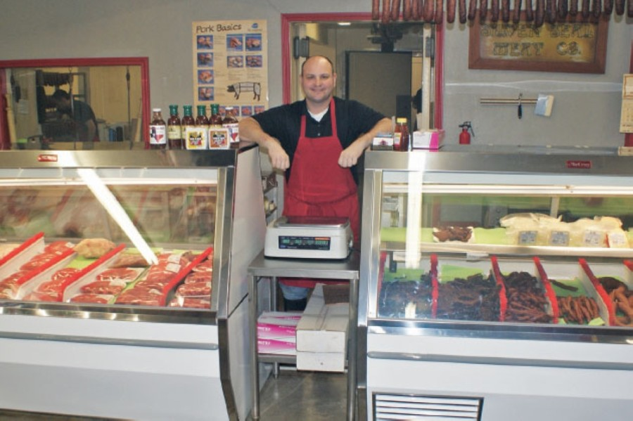 Blake Smith opened Smitty's Meat Market and Smokehouse in December 2013 in Tomball. This photo is from a December 2014 story in Community Impact Newspaper. (Community Impact Newspaper staff)