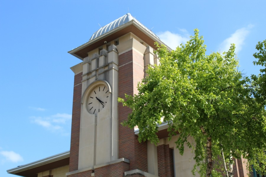 The clock tower on Keller City Hall and a tree