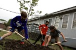 Students helped to plant one of three Mexican sycamore trees that were donated to the school. (Lauren Canterberry/Community Impact Newspaper)