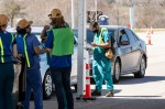 Photo of nurses offering drive-thru vaccines