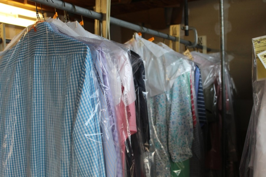 Council Member Anthony Maroulis organized an effort to return clothing at the business to members of the community. (Ian Pribanic/Community Impact Newspaper)