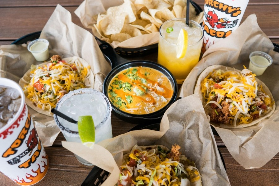 Torchy's Tacos serves a variety of unique taco offerings alongside chips and queso, street corn, guacamole and salsa. (Courtesy Torchy's Tacos)