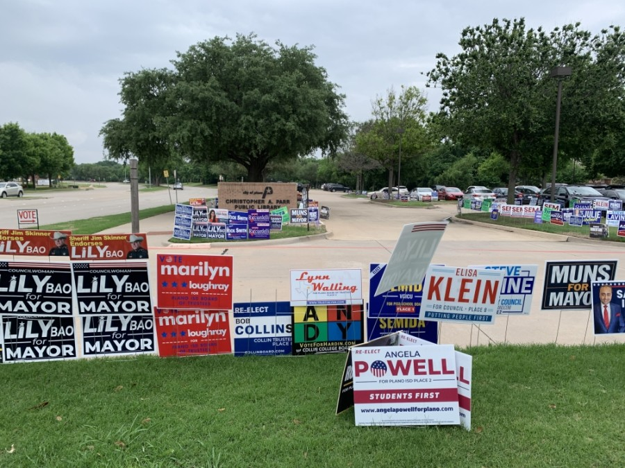Signs are strategically placed on election day at the Christopher A. Parr Public Library in Plano. Vicki Chen/Community Impact Newspaper