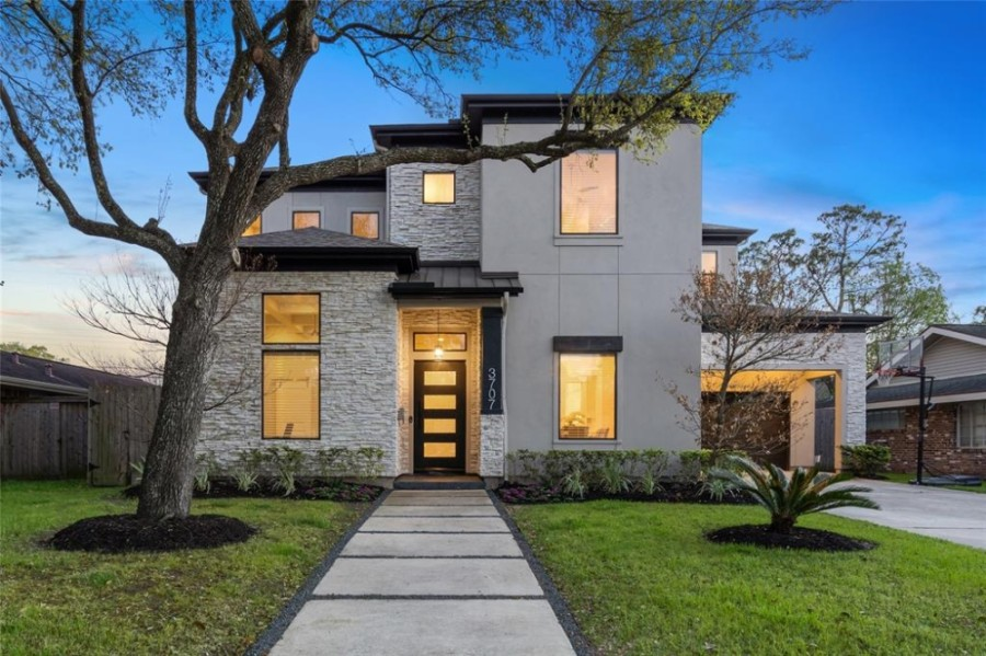 3707 Sun Valley Drive, Houston: A recent construction, this home features a clean aesthetic with modern lines located in central Houston near the Texas Medical Center. Features a chef's kitchen with an oversized island, luxury-brand appliances, a butler's pantry, and a walk-in pantry. The kitchen adjoins the family room, which offers views to a roofed patio and a lawn beyond that. The home additionally features a primary suite with a spa-like bath and an oversized closet. 4 bed, 4 full and 1 half bath/4,101 sq. ft. Sold for $827,001-$947,000 on April 29. (Courtesy Houston Association of Realtors)